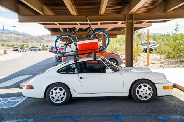 PinkBike: As seen recently in Death Valley: an 80s something Porsche 911 with a Yakima roof rack with all the trimmings.